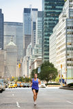 Running workout in New York City - Male runner stock images