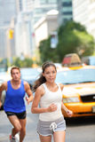 Running workout in New York City - Runners couple Stock Photography