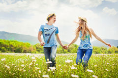 Running young couple. Pretty young couple in the fields Stock Images
