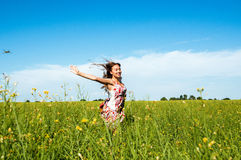 Running young girl Stock Image