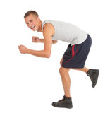 Running young man in sport cothes Royalty Free Stock Images