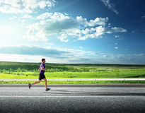 Running young man. Sunset and running young man Royalty Free Stock Photo