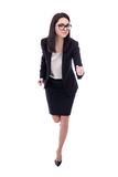 Running young woman in business suit isolated on white Stock Photos