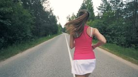 Running young woman in the forest. Healthy slim young sportswoman running. stock video