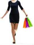 Running young woman holding shopping bags Royalty Free Stock Photos