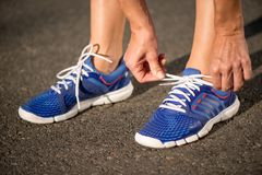 Runnning shoes on runner, close-up Stock Photo