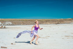 Runnung woman in violet dress Stock Photography
