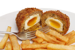 Runny scotch egg and chips Stock Images