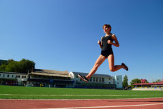 She runs around the stadium Royalty Free Stock Photo