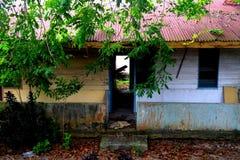 Runt om Belakang Padang 4 - hus i by Arkivfoton