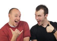 runt om goofing grabbar två Royaltyfri Foto