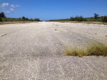 Runway Able on Tinian. Runway Able of the American World War II airbase on Tinian in the Mariana Islands. The Enola Gay B-29 bomber took off from this runway Royalty Free Stock Photo