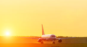 Runway airport airplane silhouette in the morning at dawn sunset sun light Stock Photography