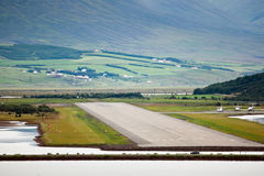 View of airport runway from sea, Akureyri - Iceland Stock Photo