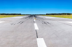 Runway at the airport and the blue sky conceptual aviation Royalty Free Stock Images