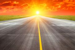 Runway at the airport the horizon at sunset in the center of the sun. Runway at the airport the horizon at sunset in the center of the sun Royalty Free Stock Photos