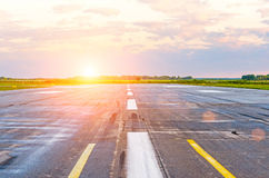 Runway at the airport in the morning at dawn sunset sun light Royalty Free Stock Photography