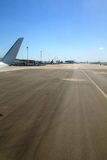 View along an empty runway on a sunny day Royalty Free Stock Photography