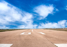 Runway airstrip, aviation. Runway, airstrip on a bluesky background, aviation concept Royalty Free Stock Images
