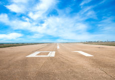 Runway airstrip, aviation. Runway, airstrip on a bluesky background, aviation concept Stock Photography