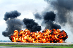 Runway explosion (Demonstration). Rhode Island National Guard simulates an airport takeover during the 2011 Quonset Airshow.  As part of the demonstration Stock Photos
