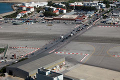 Runway of Gibraltar airport. The runway of the Gibraltar airport forms the frontier between Spain and the British colony. A road with four lanes crosses the royalty free stock photography