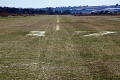 Runway on grass. Used for landing and take-off of light airplanes royalty free stock photo