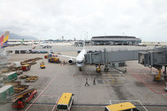 Runway of Hong Kong International Airport site. Passenger aircraft on the runway of Hong Kong International Airport site royalty free stock photography