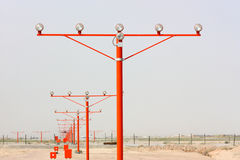 Runway lights. On orange post on clear sky background Royalty Free Stock Image
