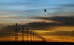 Runway lights and silhouette of a helicopter Royalty Free Stock Photography