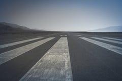 Runway. Long paved runway shot from its threshold markings stock photography