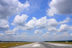 Runway Over Cloudscape Royalty Free Stock Images