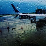 Runway Picture. Windowshot airport rain airplane runway royalty free stock photography
