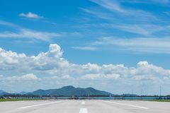 Runway for plane landing or takeoff in blue sky Royalty Free Stock Photos