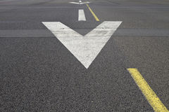Runway surface arrow. Arrows on the surface of an airport runway Royalty Free Stock Photo