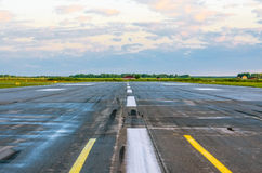 Runway takeoff airplane flight travel sky clouds.  Royalty Free Stock Image