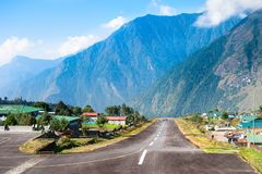 Runway of the Tenzing-Hillary airport in Lukla, Himalayas, Nepal royalty free stock image