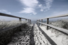 Runway to the ocean monochrome and blue. This is a monochrome picture with blue details of a beautiful view to the ocean of the island of Sylt near Westerland in Stock Photography