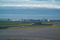 Runways and hangars at an airport. Runways and hangars at Schiphol Airport in Amsterdam Stock Image