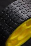 Ruota di automobile gialla del giocattolo Fotografia Stock Libera da Diritti