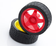 Ruota di automobile rossa e gialla del giocattolo Fotografia Stock Libera da Diritti