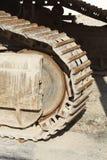 Ruote a catena di un escavatore Fotografia Stock