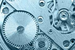 Ruote di ingranaggio dentro l'orologio Lavoro di squadra di concetto Macro Immagine Stock