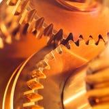 Ruote di ingranaggio dorate Fotografie Stock