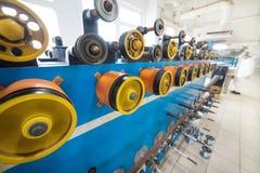 Ruote gommate giranti della bobinatrice Fotografia Stock
