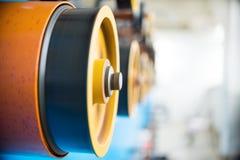 Ruote gommate giranti della bobinatrice Fotografie Stock Libere da Diritti