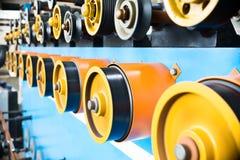 Ruote gommate giranti della bobinatrice Immagine Stock
