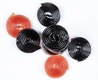 Ruote rosse e nere della liquirizia Fotografia Stock