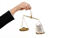 Rupee coin and Indian currency notes in justice scale. Against white background Stock Photo