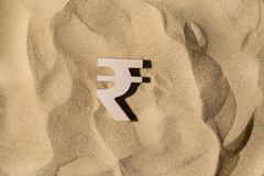 Rupee Sign On the Sand royalty free stock photography